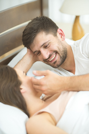 room accents: The romantic couple lay in the bed