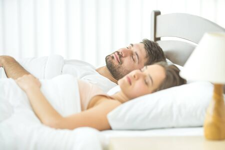 The couple sleeping in the comfortable bed Stock Photo