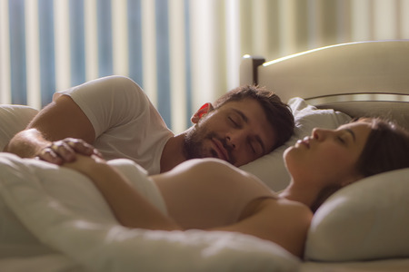 room accents: The man sleeping near the woman in the bed