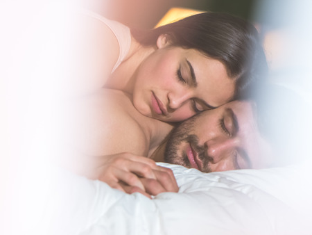 The young couple relax in the bed