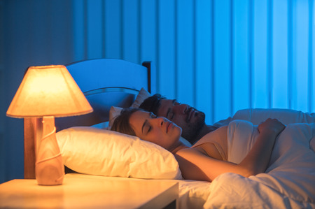 The man and woman sleeping in the bed. night time, full grip focus