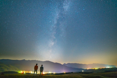 The two friends stand on the background of the stars. night time Reklamní fotografie - 83477123