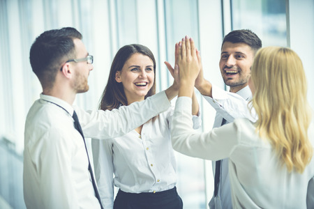 The four business people greeting with a high five stock photo the four business people greeting with a high five stock photo picture and royalty free image image 85097321 m4hsunfo