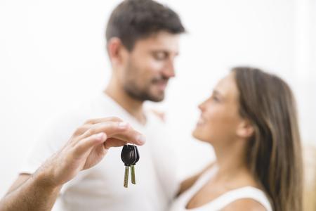 The happy couple hold keys Stock Photo