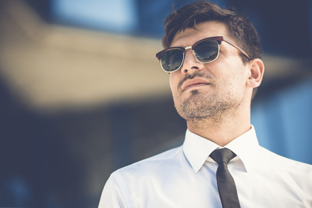 The handsome businessman in sunglasses