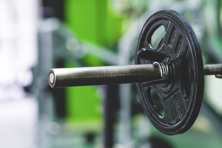 The barbell with a plate in the sport club Stock Photo