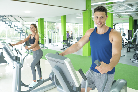 The sport couple in the cardio apparatus