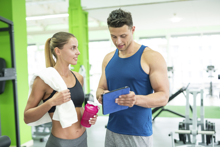 The woman discuss with a fitness instructor