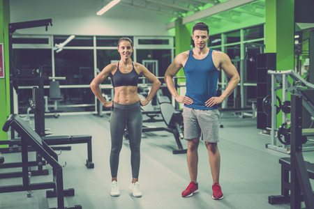 The sport couple stand in the fitness club Stock Photo