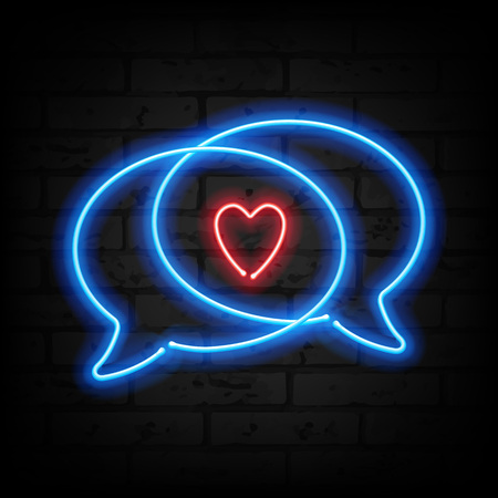 Neon heart and speech bubbles on brick wall. Love symbol. Valentines day design.