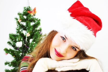 Girl and Christmas tree photo
