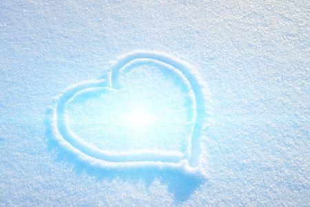 Heart on snow photo