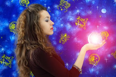 horoscope: Girl holds a glass ball