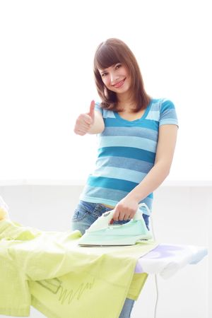 thumbup: Young woman ironing on a white background