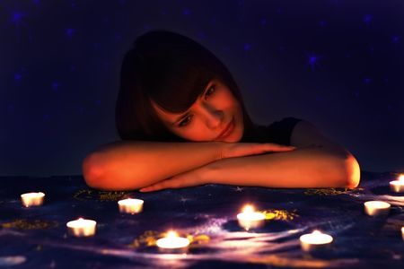 Romantic girl and candles photo