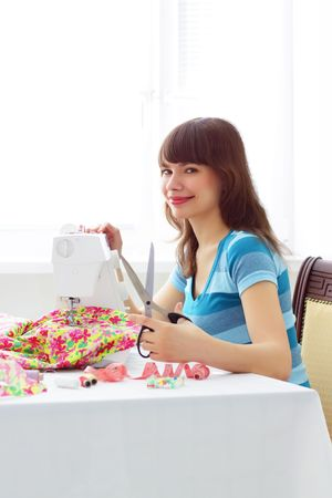 Girl and a sewing machine photo