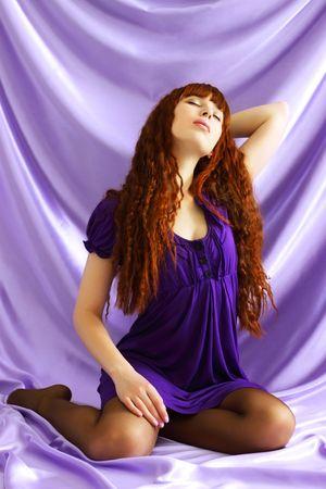 Beautiful girl on purple background photo