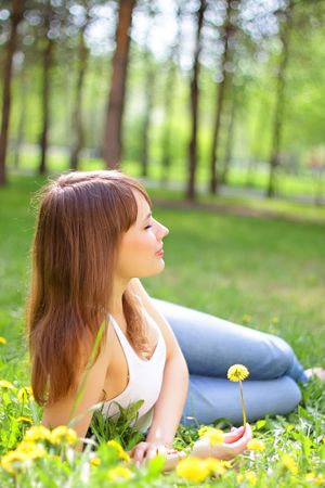Beautiful young girl lying on grass Stock Photo - 6959148