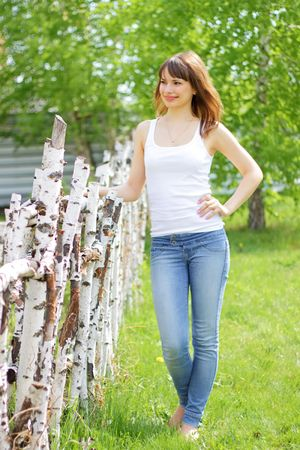 Beautiful girl on the background of wood Stock Photo - 6959154