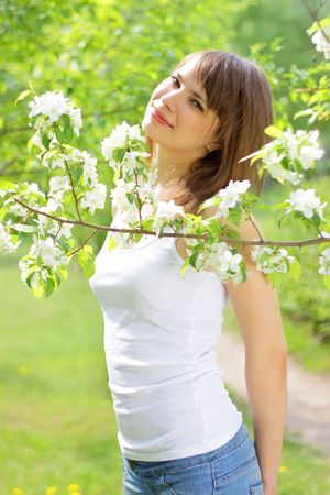 Beautiful girl about to apple tree