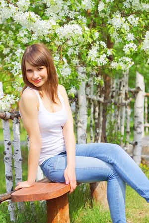 Girl on the background of the fence Stock Photo - 7317645