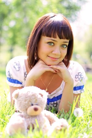 Beautiful girl lying on the grass photo
