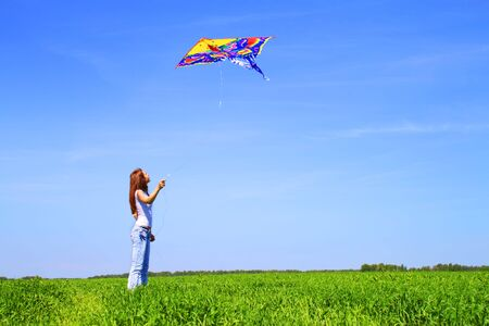 woman flying: Girl playing with a kite Stock Photo