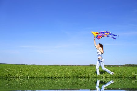 flying a kite: Girl and kite