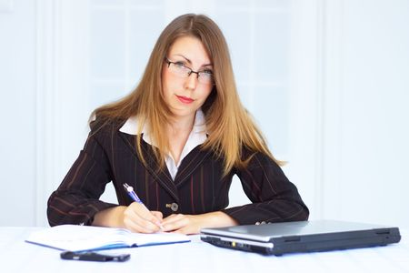 Business woman with laptop photo