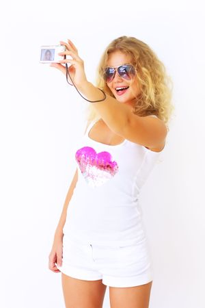 Stylish girl holding a camera photo
