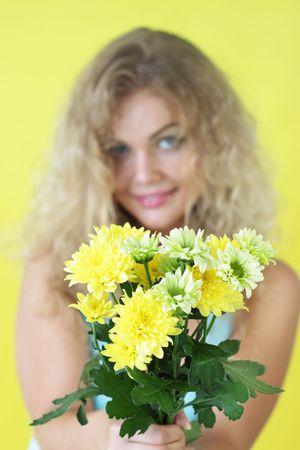 Beautiful girl holding chrysanthemums Stock Photo - 7396250