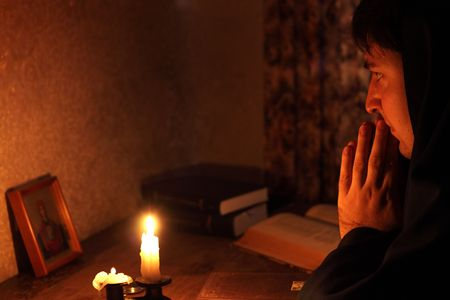 Man sitting by candlelight photo