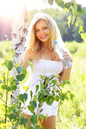 blondy: Beautiful girl holding a bottle of water