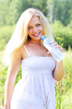 Beautiful girl holding a bottle of water Stock Photo - 7436387