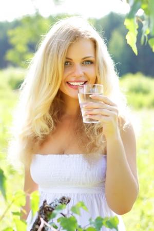 Beautiful girl holding glass of water Stock Photo - 7436385