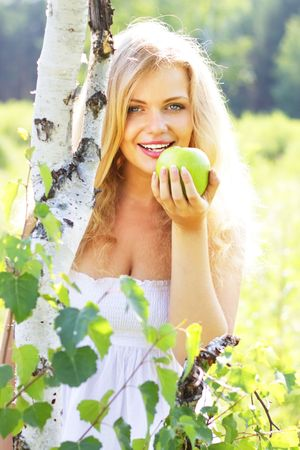 Beautiful girl holding green apple Stock Photo - 7436388