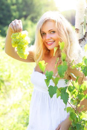 Beautiful girl holding grapes Stock Photo - 7436391