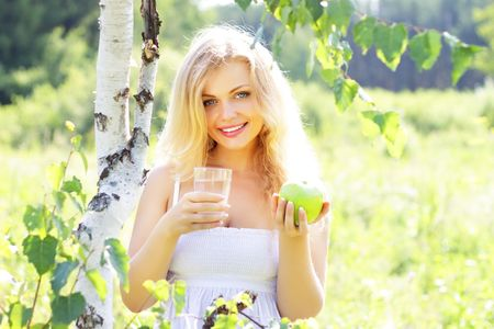 Beautiful girl holding a glass of water photo