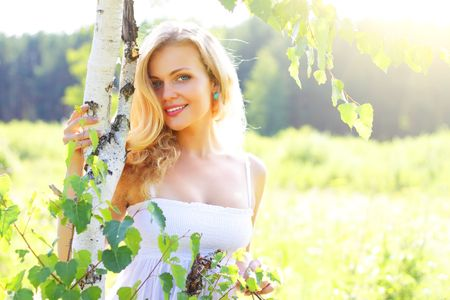 Beautiful girl near birch Stock Photo - 7436564