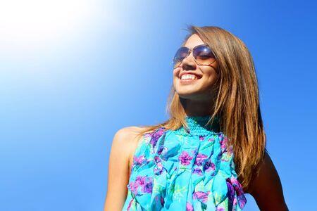 Joyful girl on a blue background Stock Photo - 7511458