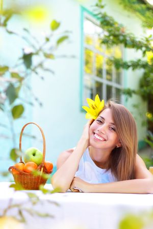 A beautiful girl sitting at the table Stock Photo - 7511444