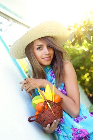 Beautiful girl holding a basket of fruit Stock Photo - 7511451