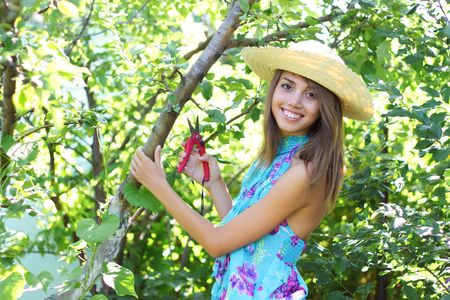 Happy girl holding secateurs Stock Photo - 7511470