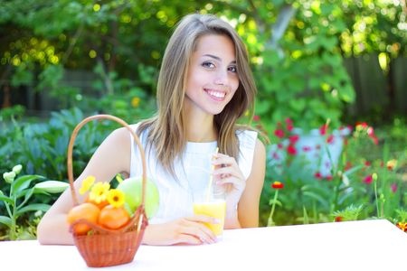 Beautiful girl sitting at the table Stock Photo - 7511455