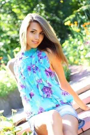 Beautiful girl in a flowered garden Stock Photo - 7511466