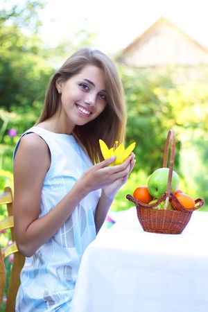 A beautiful girl sitting at the table Stock Photo - 7511450