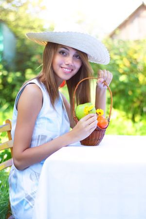 A beautiful girl sitting at the table Stock Photo - 7511446