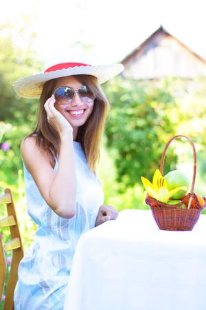 A beautiful girl sitting at the table Stock Photo - 7511442