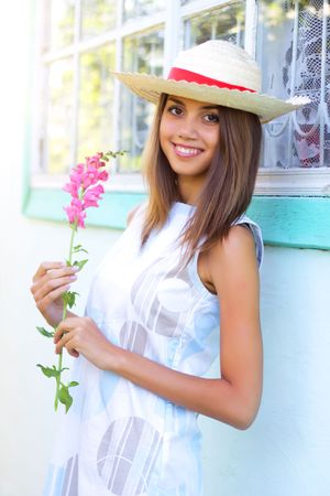 Beautiful girl holding a flower Stock Photo - 7511443