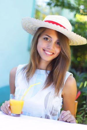Beautiful girl drinking juice Stock Photo - 7511445